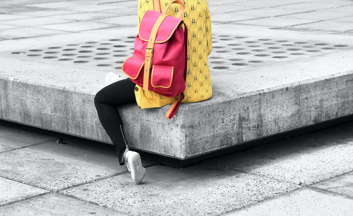 photo of woman with pink backpack