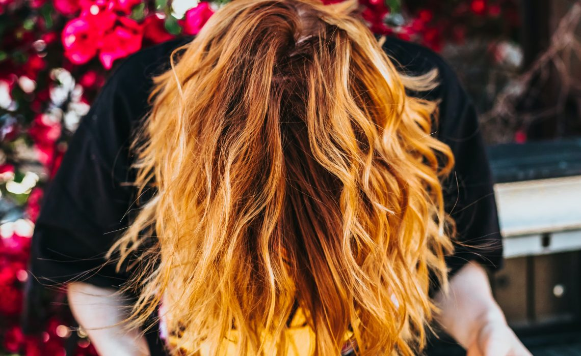 photo of woman with wavy hair upside down