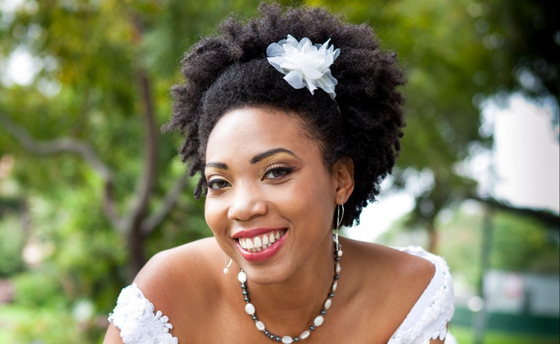 photo of woman with curly hair on her wedding