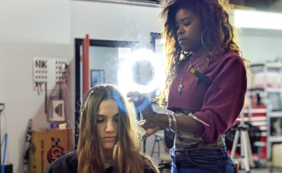 photo of woman with wavy hair getting her hair styled