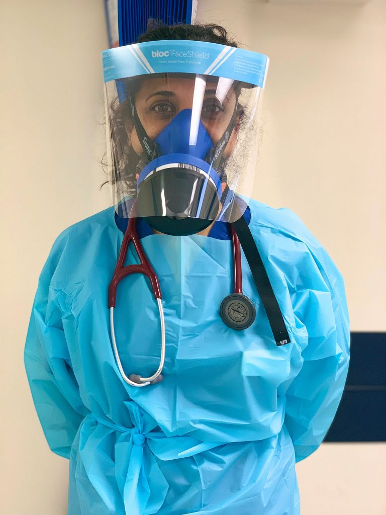 Photo of Dr. Sarb Clare in medical gear