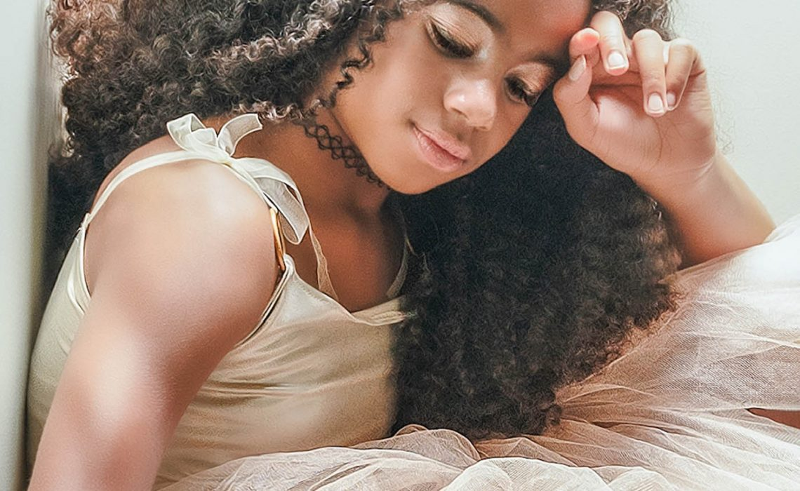photo of girl with curly hair